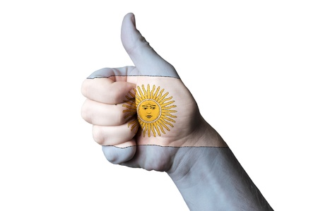 Hand with thumb up gesture in colored argentina national flag as symbol of excellence, achievement, good, - for tourism and touristic advertising, positive political, cultural, social management of country Stock Photo