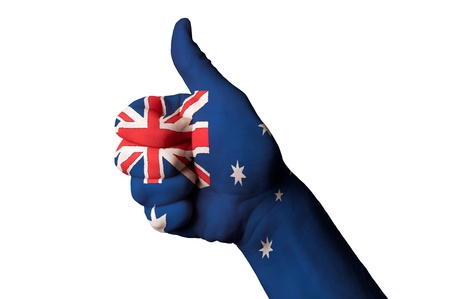 touristic: Hand with thumb up gesture in colored australia national flag as symbol of excellence, achievement, good, - for tourism and touristic advertising, positive political, cultural, social management of country
