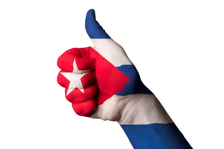 cuba flag: Hand with thumb up gesture in colored cuba national flag as symbol of excellence, achievement, good, - for tourism and touristic advertising, positive political, cultural, social management of country