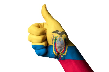 Hand with thumb up gesture in colored ecuador national flag as symbol of excellence, achievement, good, - for tourism and touristic advertising, positive political, cultural, social management of country