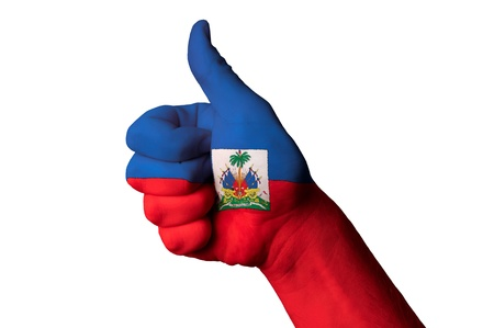 Hand with thumb up gesture in colored haiti national flag as symbol of excellence, achievement, good, - for tourism and touristic advertising, positive political, cultural, social management of country Stock Photo - 13207874