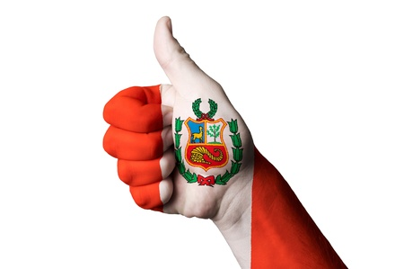 Hand with thumb up gesture in colored peru national flag as symbol of excellence, achievement, good, - for tourism and touristic advertising, positive political, cultural, social management of country Фото со стока