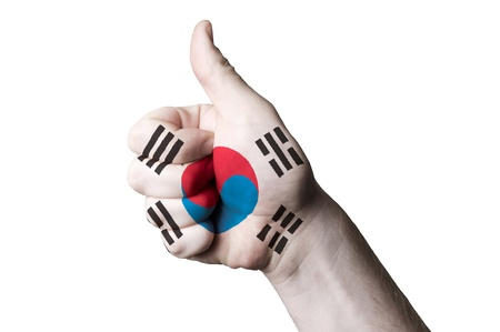 south korea flag: Hand with thumb up gesture in colored south korea national flag as symbol of excellence, achievement, good, - for tourism and touristic advertising, positive political, cultural, social management of country