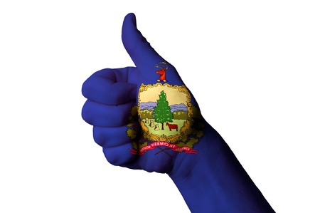 Hand with thumb up gesture in colored vermont usa state flag as symbol of excellence, achievement, good, - for tourism and touristic advertising, positive political, cultural, social management of country