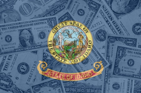 indebtedness: transparent united states of america state flag of idaho with dollar currency in background symbolizing political, economical and social government