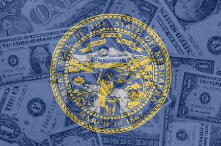 establishment states: transparent united states of america state flag of nebraska with dollar currency in background symbolizing political, economical and social government Stock Photo