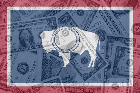 indebtedness: transparent united states of america state flag of wyoming with dollar currency in background symbolizing political, economical and social government