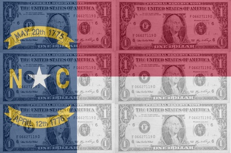 transparent united states of america state flag of north carolina with dollar currency in background symbolizing political, economical and social government photo