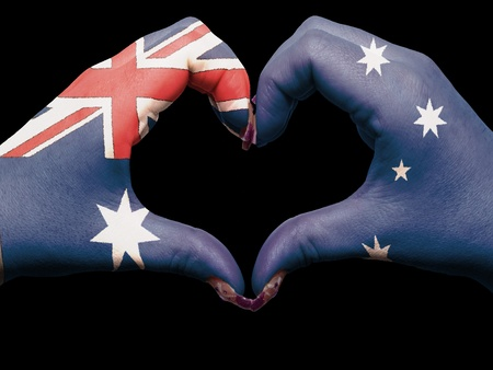 Tourist made gesture  by australia flag colored hands showing symbol of heart and love photo