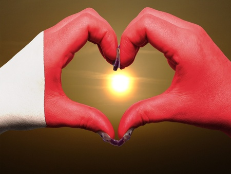 Tourist made gesture  by bahrain flag colored hands showing symbol of heart and love during sunrise photo