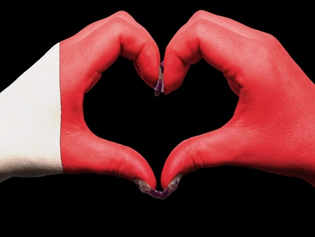 Tourist made gesture  by bahrain flag colored hands showing symbol of heart and love photo