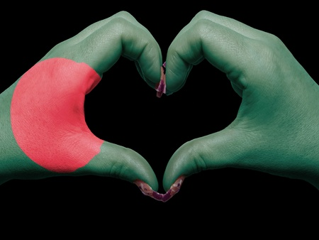 Tourist made gesture  by bangladesh flag colored hands showing symbol of heart and love photo