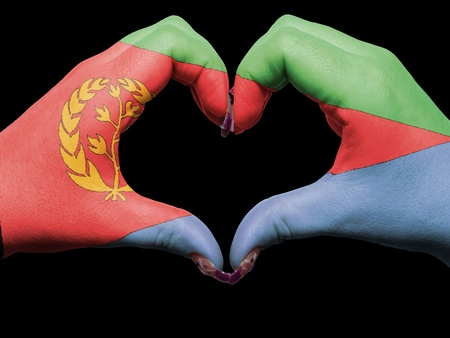 Tourist made gesture  by eritrea flag colored hands showing symbol of heart and love