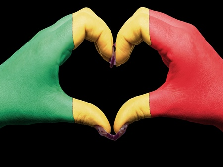 Tourist made gesture  by mali flag colored hands showing symbol of heart and love photo