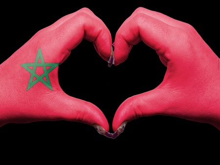 made in morocco: Tourist made gesture  by morocco flag colored hands showing symbol of heart and love