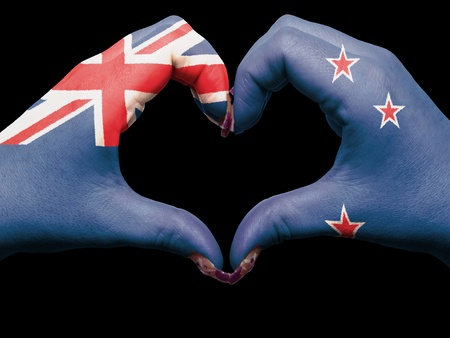 Tourist made gesture  by new zealand flag colored hands showing symbol of heart and love photo