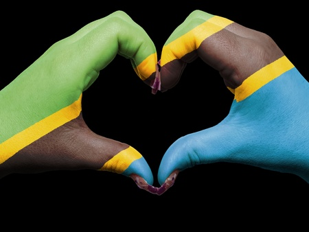 Tourist made gesture  by tanzania flag colored hands showing symbol of heart and love Stock Photo - 13563991