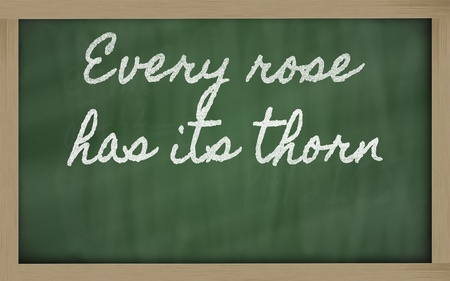 has: handwriting blackboard writings -  Every rose has its thorn Stock Photo