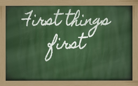 handwriting blackboard writings - First things first Stock Photo - 13564051