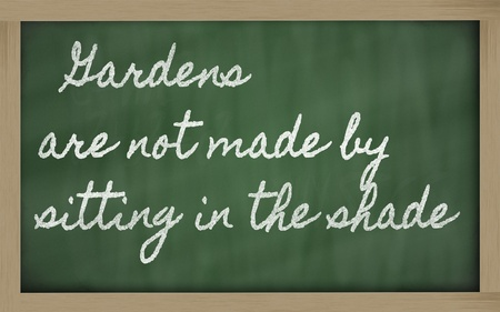 handwriting blackboard writings - Gardens are not made by sitting in the shade Stock Photo - 13564073