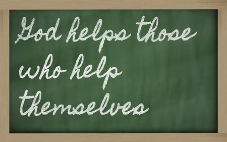 handwriting blackboard writings - God helps those who help themselves Stock Photo - 13564071
