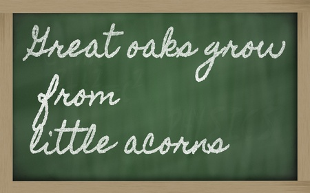 handwriting blackboard writings - Great oaks grow from little acorns Stock Photo - 13564080
