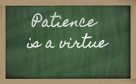virtue: handwriting blackboard writings - Patience is a virtue Stock Photo