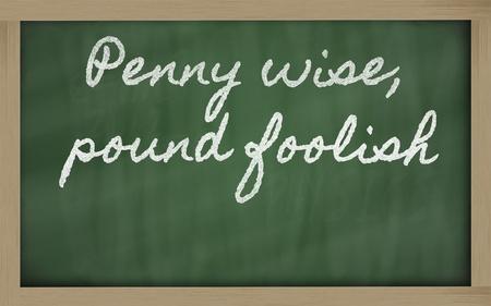 foolish: handwriting blackboard writings - Penny wise, pound foolish Stock Photo