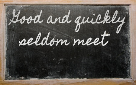 thoroughly: handwriting blackboard writings - Good and quickly seldom meet Stock Photo