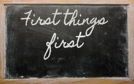handwriting blackboard writings - First things first Stock Photo - 13564075