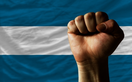 el salvadoran: complete national flag of el salvador covers whole frame, waved, crunched and very natural looking. In front plan is clenched fist symbolizing determination Stock Photo