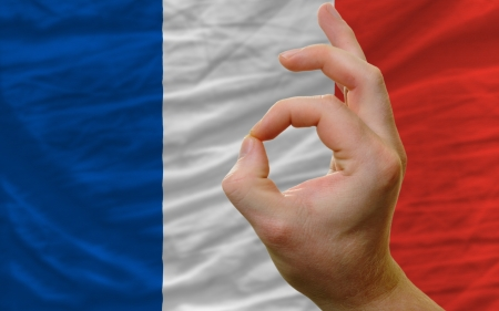 man showing excellence or ok gesture in front of complete wavy france national flag of  symbolizing best quality, positivity and succes Stock Photo - 14428165