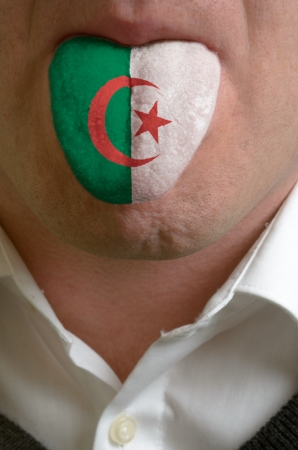 man wit open mouth spreading tongue colored in algeria flag as symbol of values like teaching, learning, multilingual speaking different of languages Stock Photo - 15002764