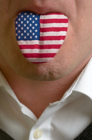 learn english: man wit open mouth spreading tongue colored in america flag as symbol of values like teaching, learning, multilingual speaking of different languages