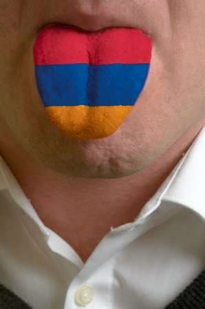 man wit open mouth spreading tongue colored in armenia flag as symbol of values like teaching, learning, multilingual speaking of different languages Stock Photo - 15002786