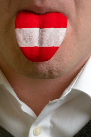 man wit open mouth spreading tongue colored in austria flag as symbol of values like teaching, learning, multilingual speaking of different languages Stock Photo - 15002772