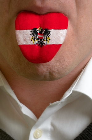 man wit open mouth spreading tongue colored in austria flag as symbol of values like teaching, learning, multilingual speaking of different languages Stock Photo - 15002831