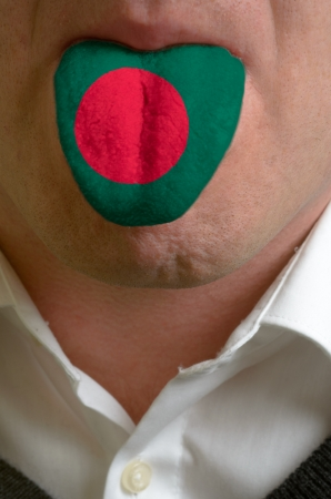 foreign national: man wit open mouth spreading tongue colored in bangladesh flag as symbol of values like teaching, learning, multilingual speaking of different languages Stock Photo