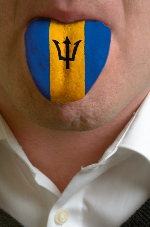 man wit open mouth spreading tongue colored in barbados flag as symbol of values like teaching, learning, multilingual speaking of different languages Stock Photo - 15002821