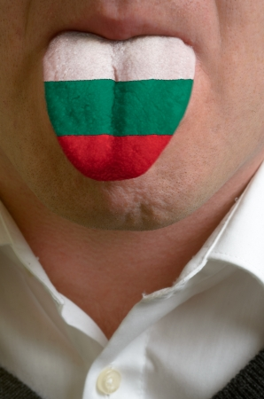 man wit open mouth spreading tongue colored in bulgaria flag as symbol of values like teaching, learning, multilingual speaking of different languages Stock Photo - 15002773