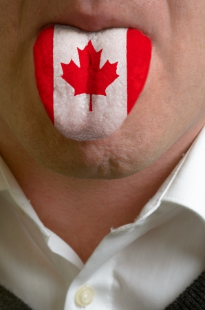 man wit open mouth spreading tongue colored in canada flag as symbol of values like teaching, learning, multilingual speaking of different languages photo