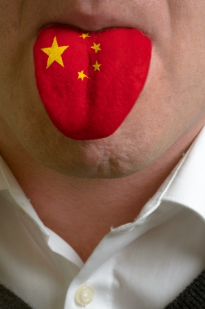 multilingual: man wit open mouth spreading tongue colored in china flag as symbol of values like teaching, learning, multilingual speaking of different languages