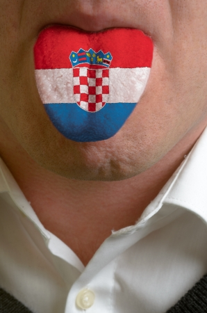 man with open mouth spreading tongue colored in croatia flag as symbol of values like teaching, learning, multilingual speaking of different languages photo
