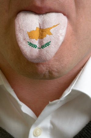 man with open mouth spreading tongue colored in cyprus flag as symbol of values like teaching, learning, multilingual speaking of different languages Stock Photo - 15002836
