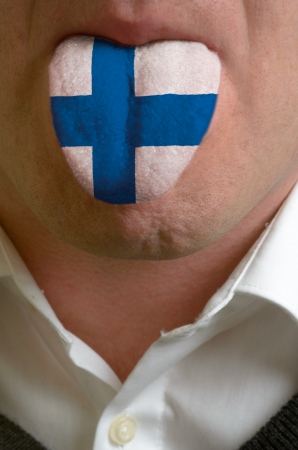 man wit open mouth spreading tongue colored in finland flag as symbol of values like teaching, learning, multilingual speaking different of languages Stock Photo - 15002779