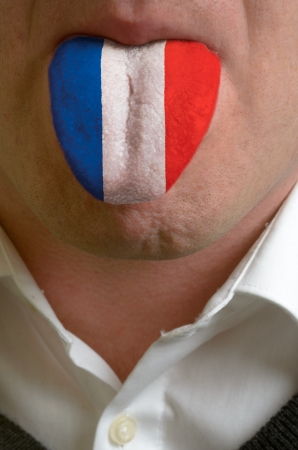 man wit open mouth spreading tongue colored in france flag as symbol of values like teaching, learning, multilingual speaking different of languages Stock Photo - 15002809