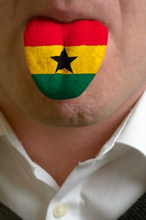man with open mouth spreading tongue colored in ghana flag as symbol of values like teaching, learning, multilingual speaking of different languages Stock Photo - 15002769