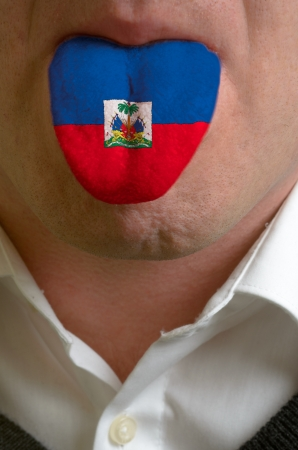 man with open mouth spreading tongue colored in haiti flag as symbol of values like teaching, learning, multilingual speaking of different languages Stock Photo - 15002788