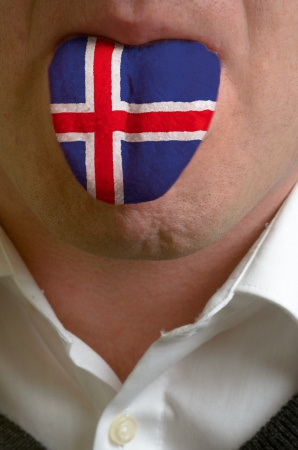 emigrant: man with open mouth spreading tongue colored in iceland flag as symbol of values like teaching, learning, multilingual speaking of different languages Stock Photo