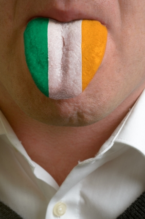man wit open mouth spreading tongue colored in ireland flag as symbol of values like teaching, learning, multilingual speaking different of languages Stock Photo - 15002775